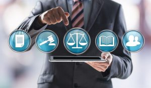 Personal Injury Lawyer selecting an application and reviewing case files.