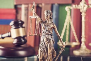 Personal Injury Lawyer office with Lady Justice on his desk.