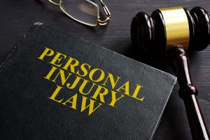 Personal Injury Law book and case file, Attorneys overlooking the Dog Bite case.